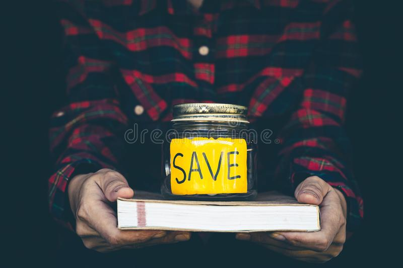 Woman keep the money in the piggy bank to be used for educational purposes, Banking and saving concept royalty free stock photo