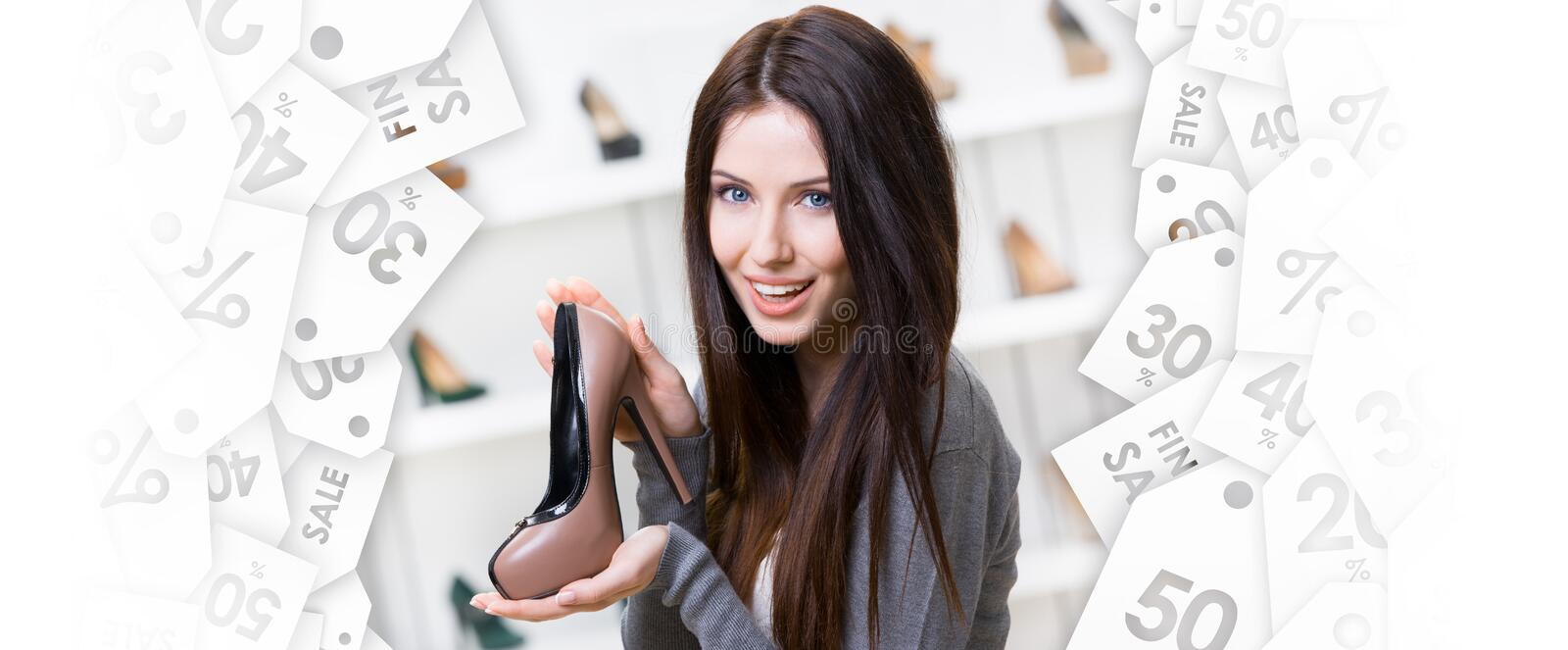 Woman keeping coffee-colored shoe. Black Friday sale stock image