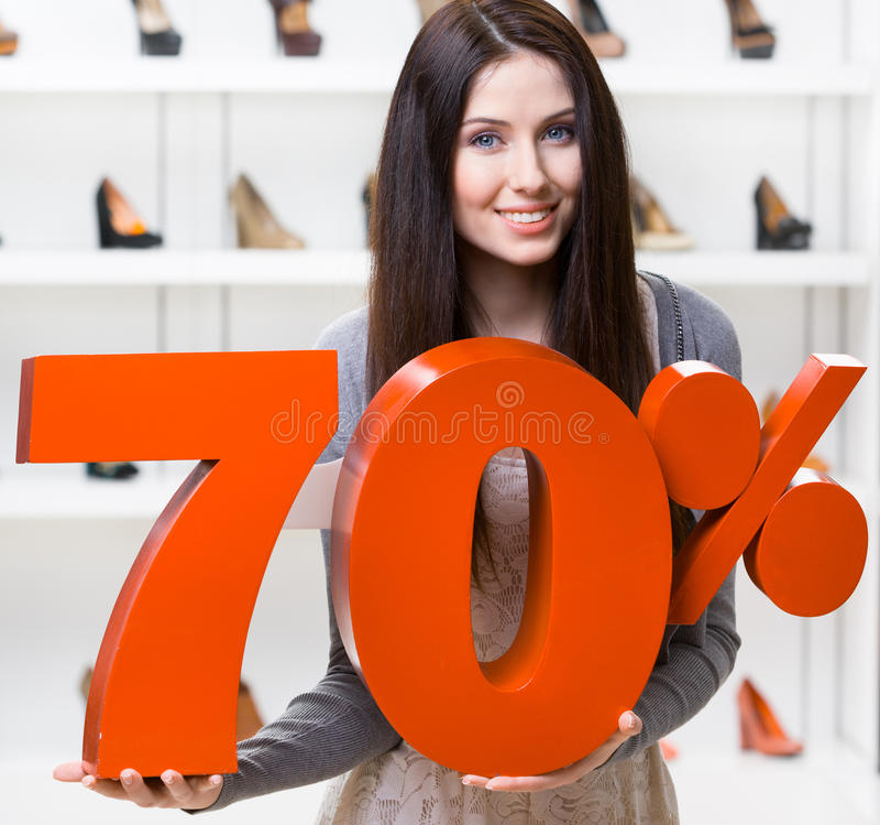 Woman Keeps The Model Of 70  Sale On Footwear Stock Photo