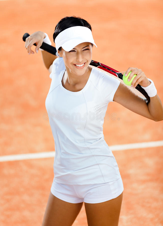 Download Woman Keeps Tennis Racquet On Her Shoulders Royalty Free Stock Photo - Image: 26982955