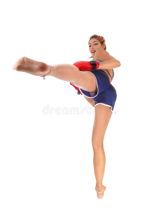 Woman kickboxing. royalty free stock image