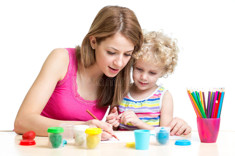 Woman and kid girl paint royalty free stock images