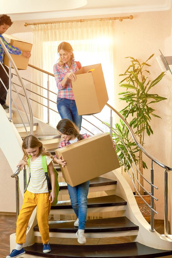 Woman and kids cardboard boxes. stock images