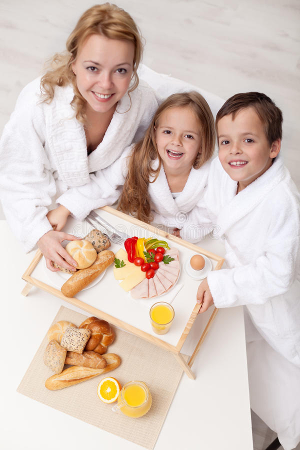 Woman And Kids Having A Light And Healthy Snack Stock Photo