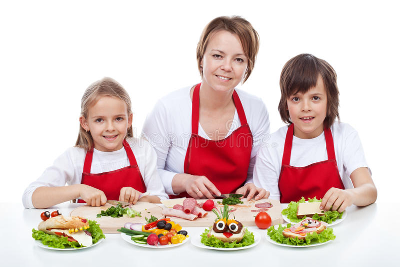 Woman and kids making creative food creature sandwiches. Together - isolated royalty free stock images