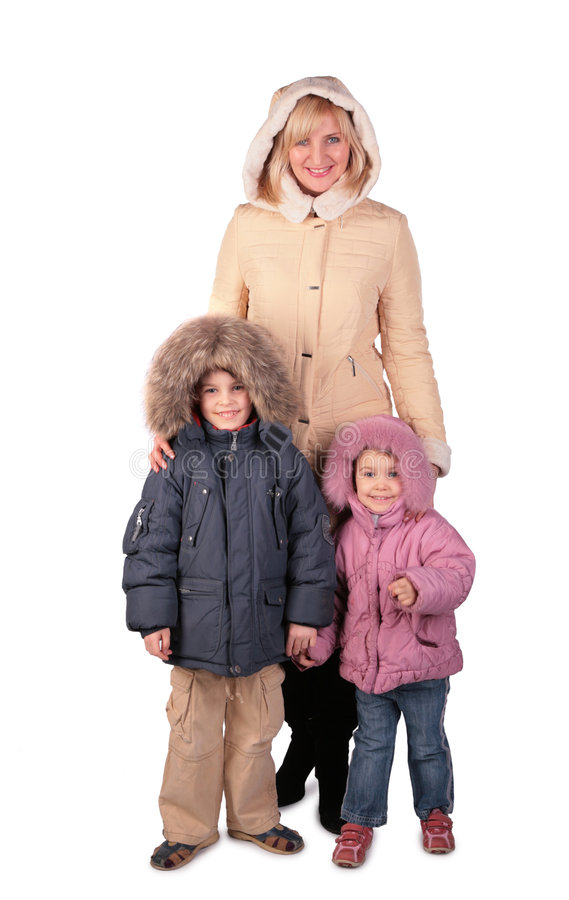 Woman with kids in winter dresses. On white royalty free stock photo
