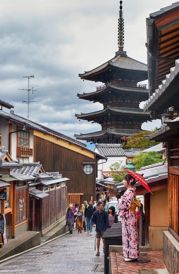 Woman in kimono on old street of Higashiyama with Hokan-ji Temple  on the background. Kyoto. Japan royalty free stock image