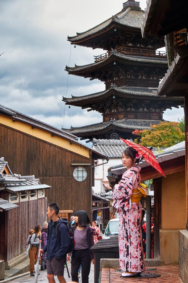 Woman in kimono on old street of Higashiyama with Hokan-ji Temple  on the background. Kyoto. Japan stock photography