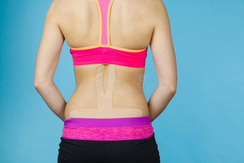 Woman with medical kinesio taping on back stock photography