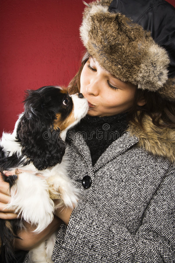 Woman kissing dog. royalty free stock images