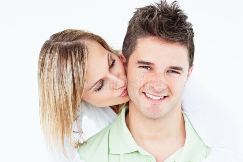 Woman kissing her happy boyfriend royalty free stock photo