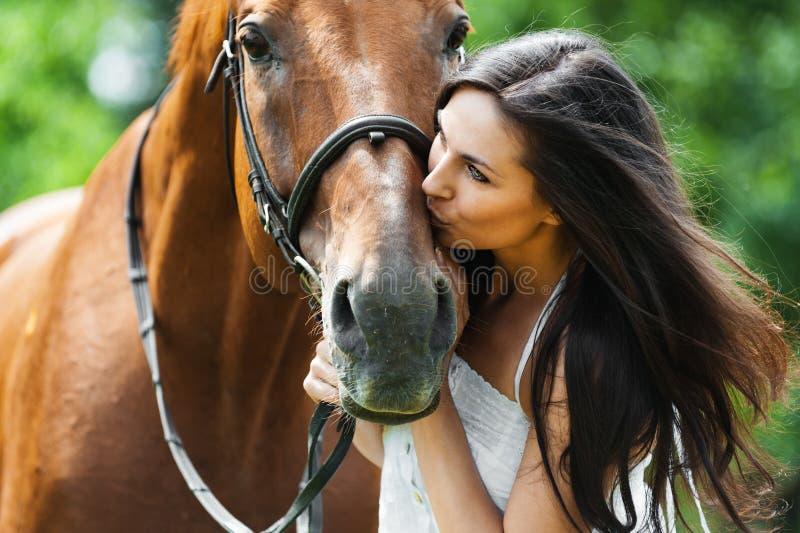 Woman kissing horse