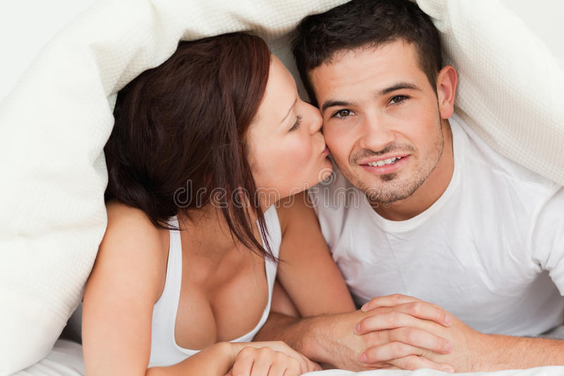 Download Woman Kissing Man On The Cheek Stock Image - Image: 20568353