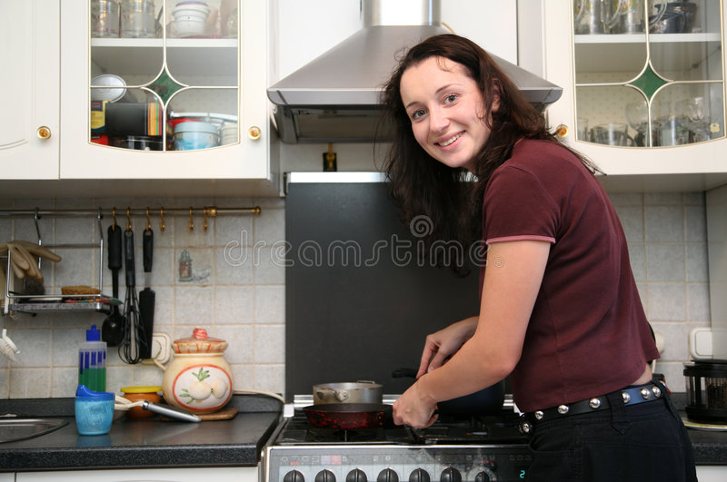 Woman on the kitchen royalty free stock image