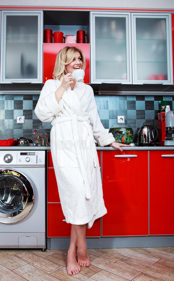 Woman In The Kitchen With Cup Tea Royalty Free Stock Photography