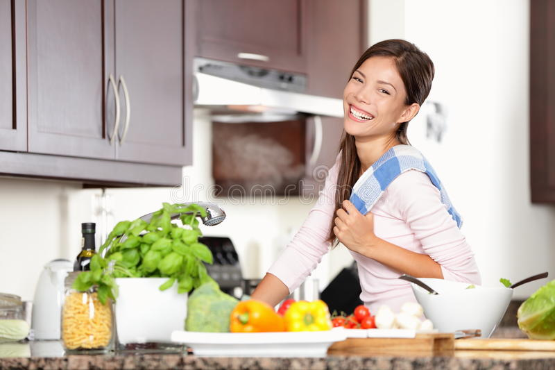 Woman in kitchen making food happy royalty free stock photography