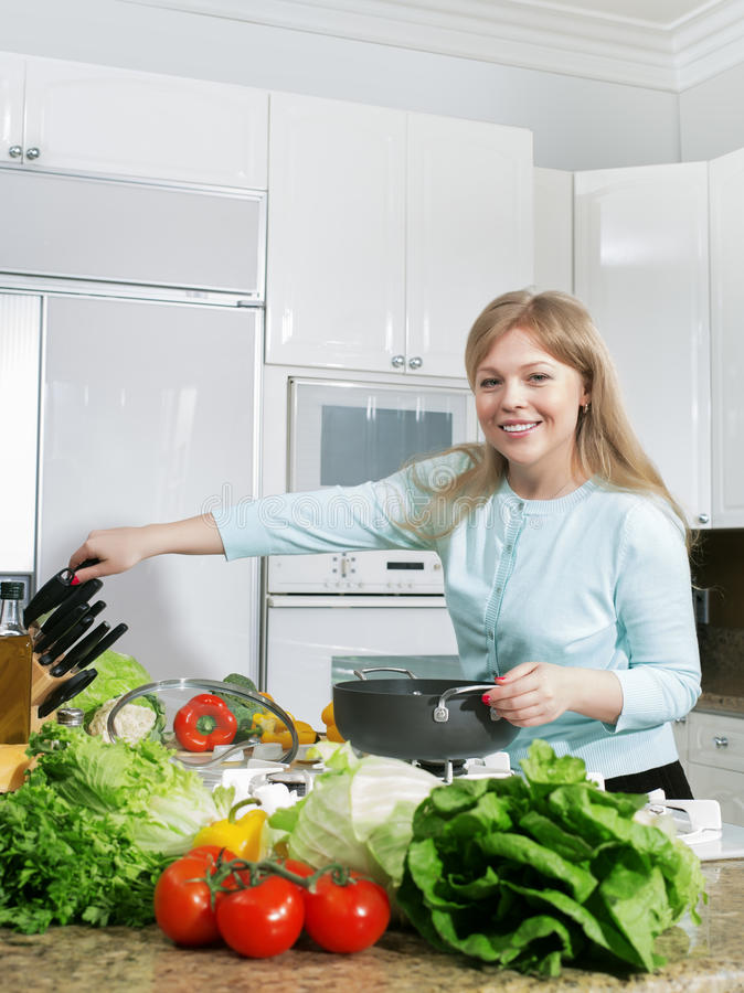 Woman on kitchen royalty free stock images