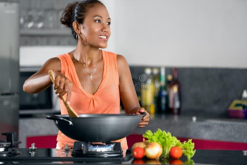 Woman in kitchen preparing food stock photos