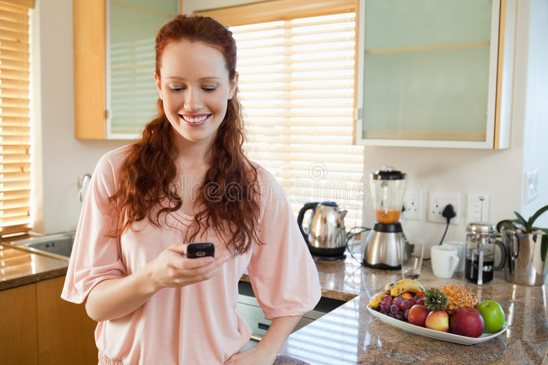 Download Woman In The Kitchen Writing Text Message Stock Photo - Image: 22439480