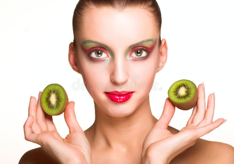 Woman with kiwi. Beautiful woman`s face with kiwi isolated on whiterr royalty free stock photography