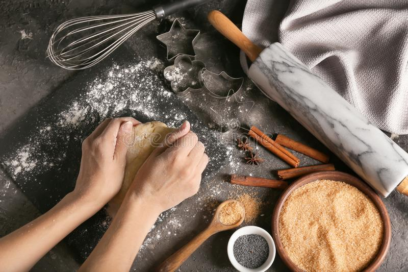 Woman kneading dough on table royalty free stock image