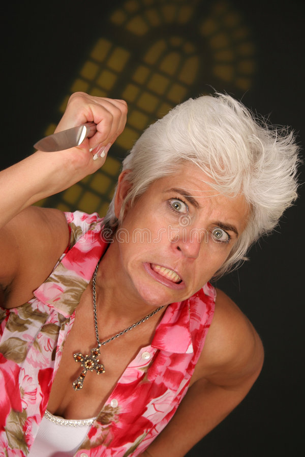 Woman with knife royalty free stock image