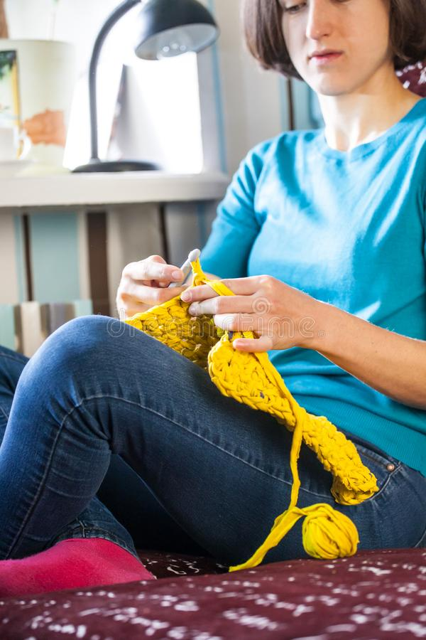 Woman knits crochet. royalty free stock image