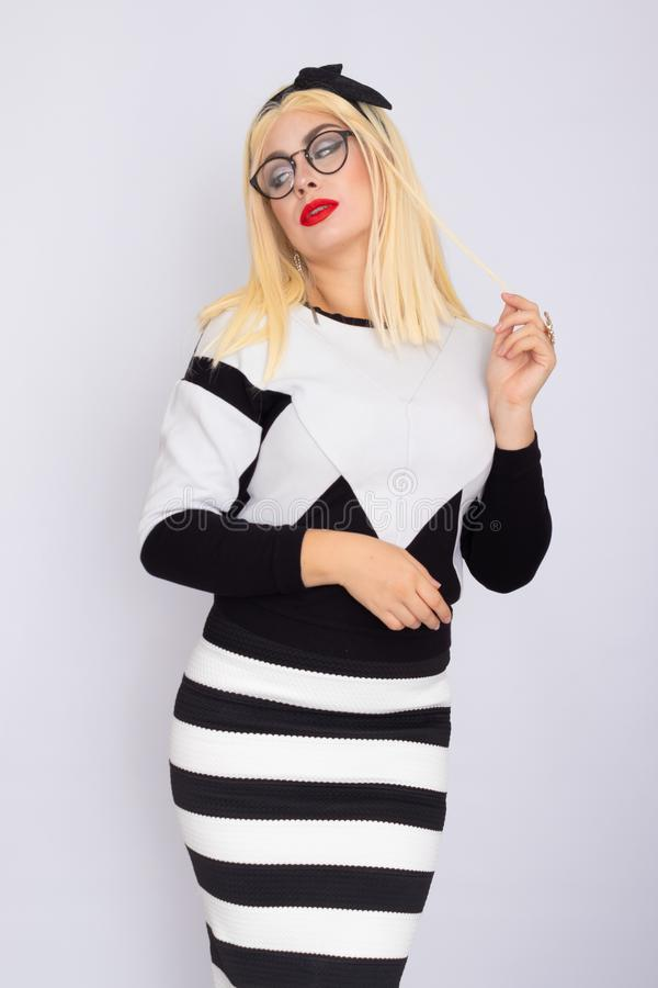 Woman in knitted costume wearing glasses stock image
