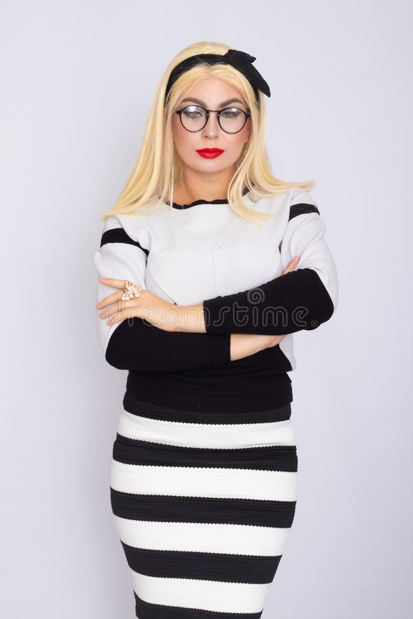 Woman in knitted costume wearing glasses stock images