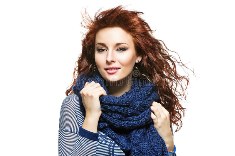 Woman with knitted wool scarf. Young beautiful woman with knitted blue wool scarf wrapped around her neck stock images