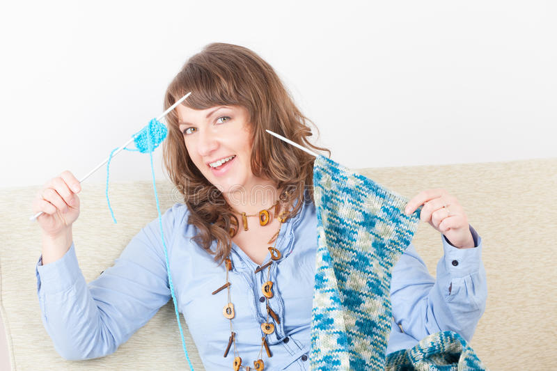 Woman knitting royalty free stock photography