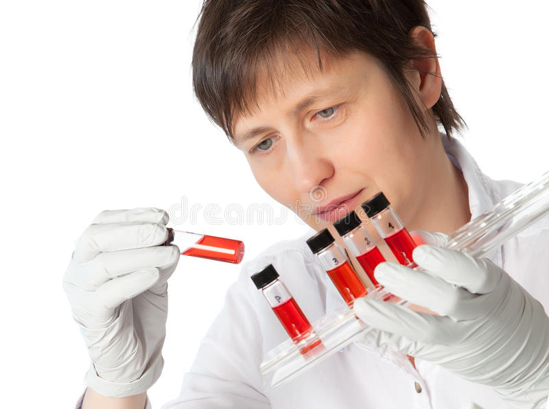 Download Woman In Lab Coat With  Liquid Samples. Stock Image - Image: 31068013
