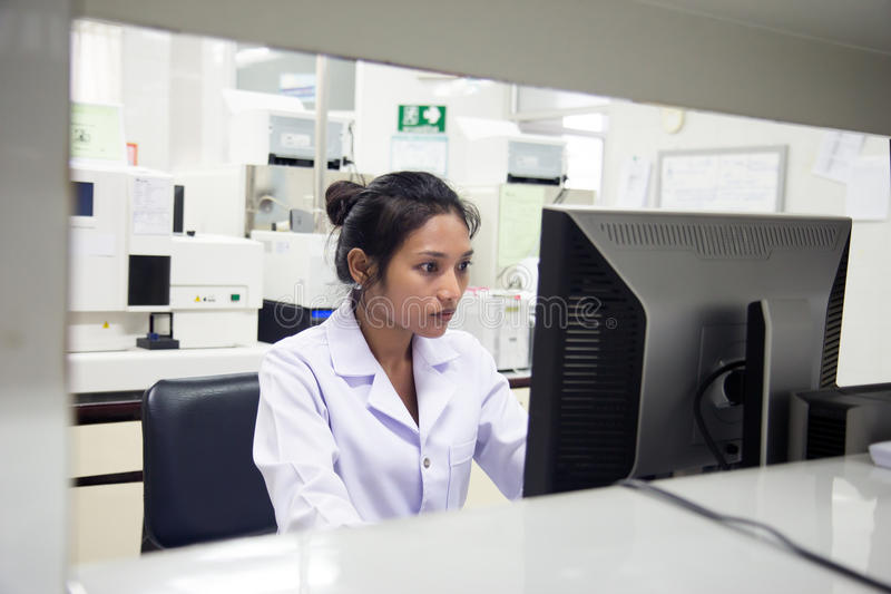 Woman in a laboratory royalty free stock image