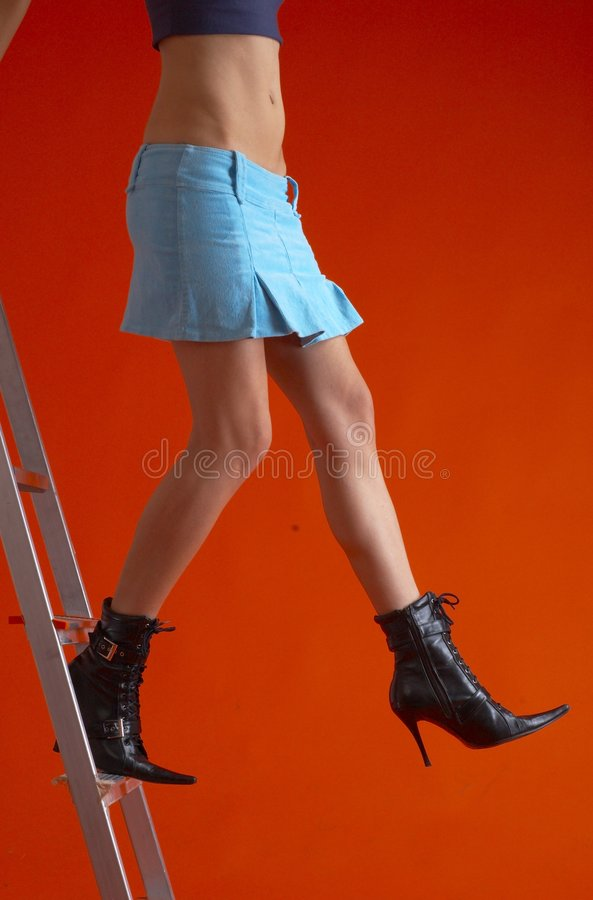 Woman On Ladder 4 stock photo
