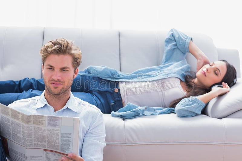Download Woman Laid On A Couch Listening To Music Stock Image - Image: 31802059