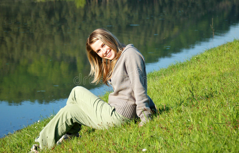 Woman on lake edge royalty free stock photo