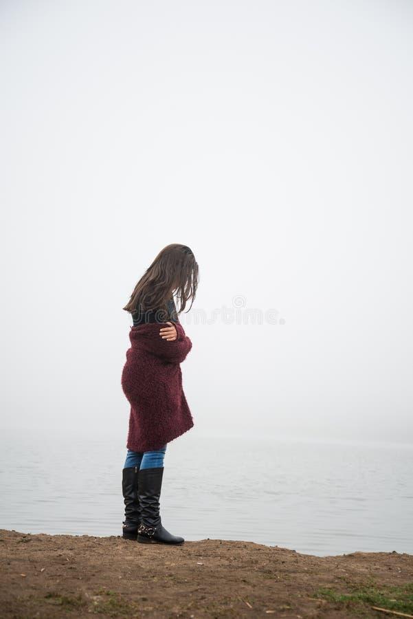 Woman on lake royalty free stock photo