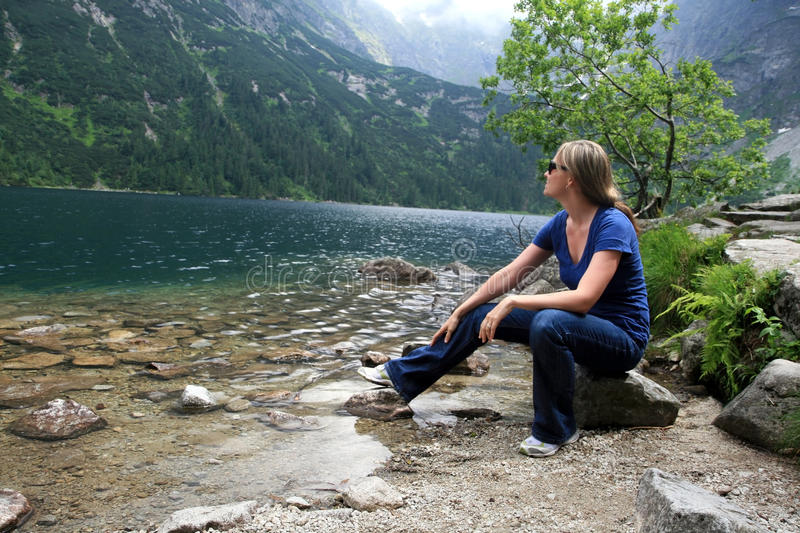 Woman by Lakeside stock photos