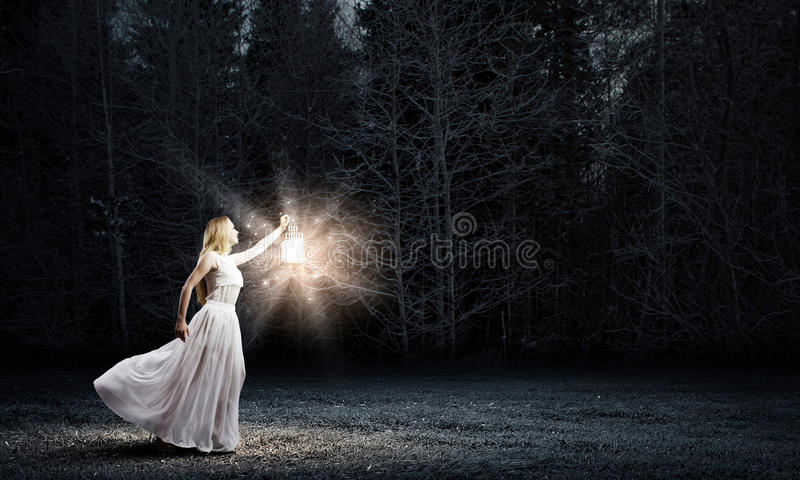 Woman with lantern royalty free stock photo