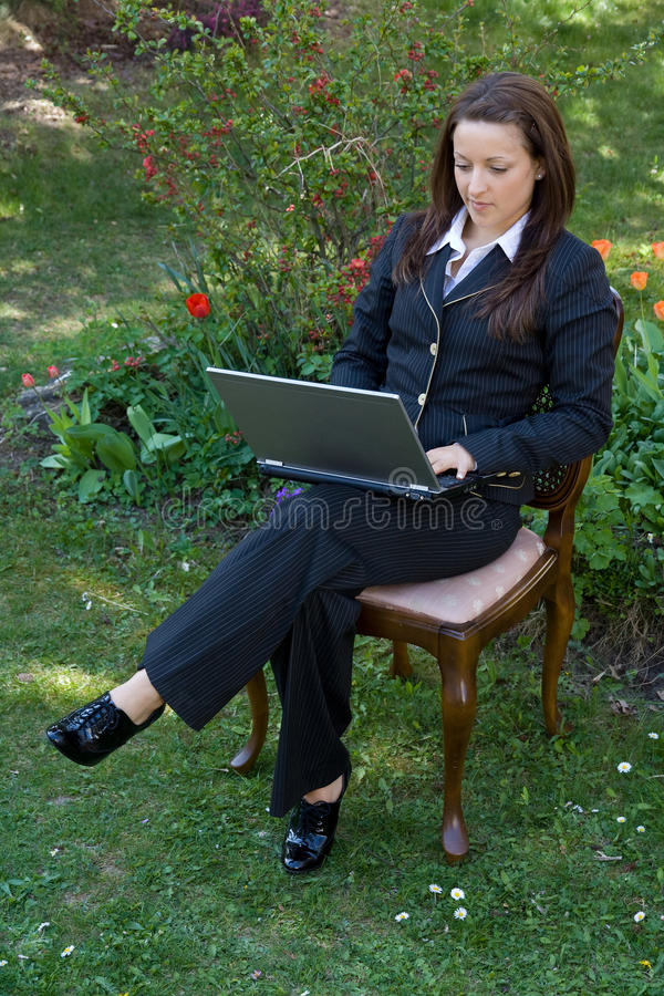Download Woman with laptop stock photo. Image of garden, office - 14030696