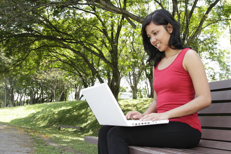 Download Woman with laptop stock image. Image of trees, side, female - 16715939