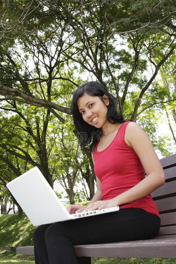 Download Woman with laptop stock photo. Image of vertical, trees - 16716064
