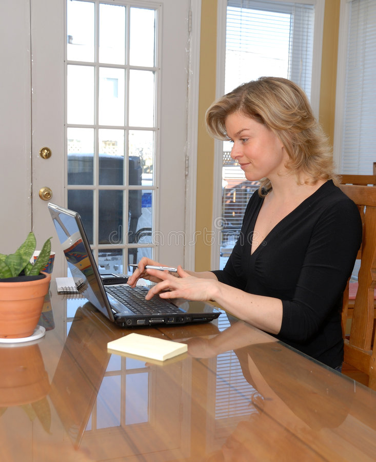 Woman on laptop stock photography
