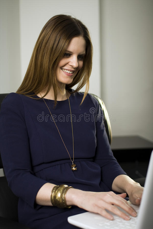Woman Using Laptop At Home Royalty Free Stock Photography