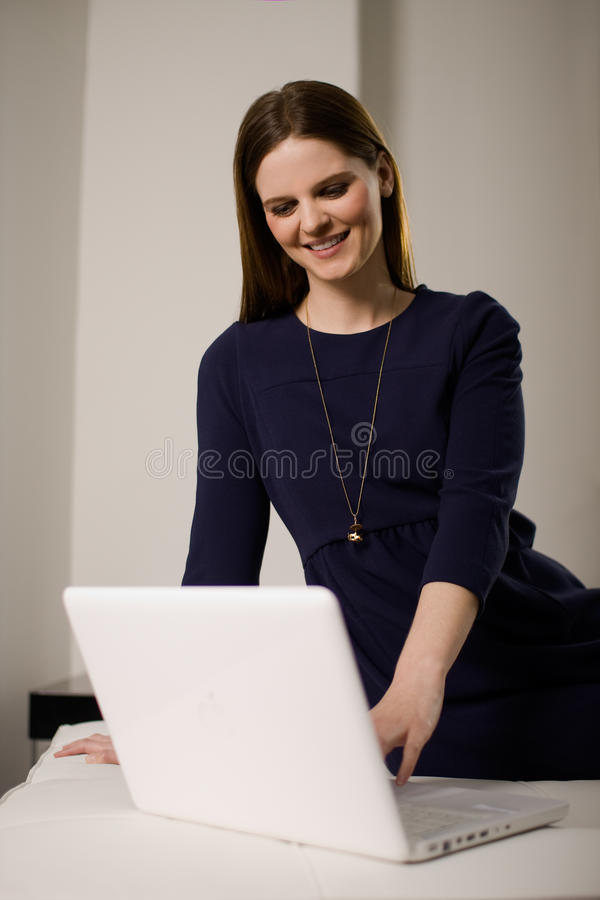 Smiling Woman Using Laptop Computer Royalty Free Stock Images