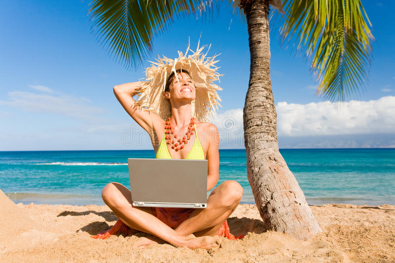 Woman laptop beach. Woman working with laptop computer on tropical resort beach