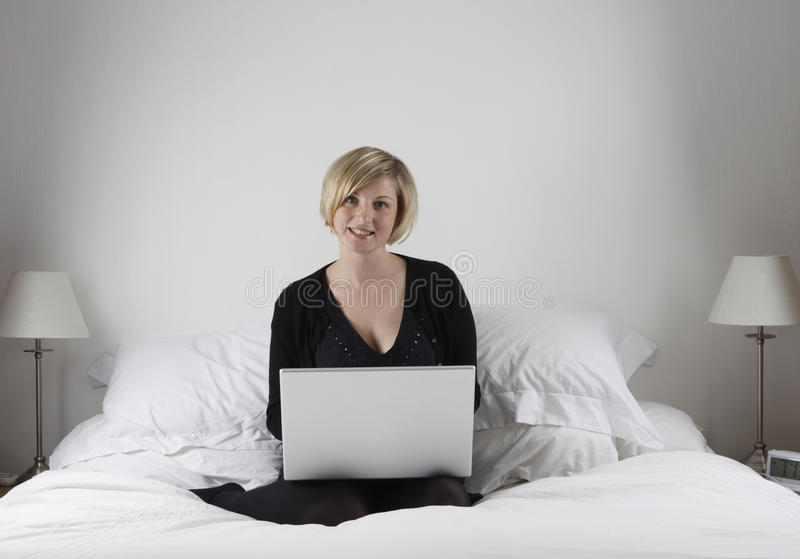 Download Woman with laptop in bed stock photo. Image of computer - 9596748