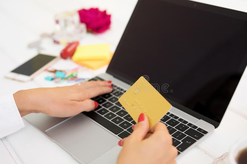 Woman with laptop computer and credit card royalty free stock photography