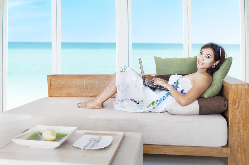 Download Woman with laptop on couch stock photo. Image of fruit - 26581868