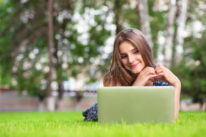 Woman with laptop at home happy showing love with hands in heart shape royalty free stock image